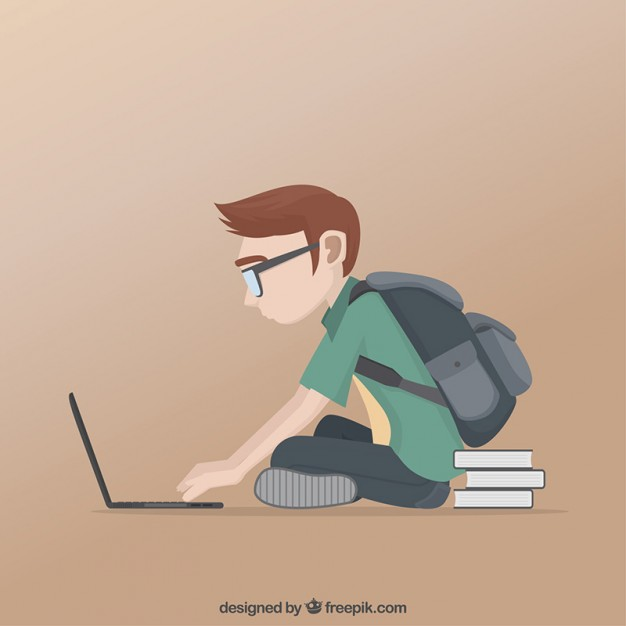 Schoolboy studying in his laptop