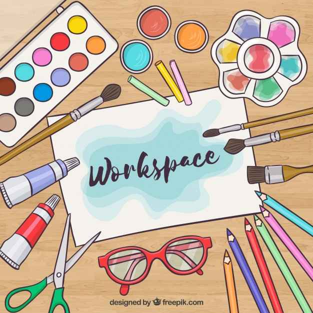creative workspace with watercolor elements