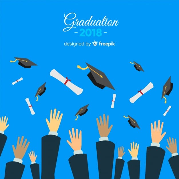 Hands throwing graduation hats in the air