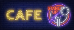 Cafe stand up neon sign. glowing bar microphone in circle frame