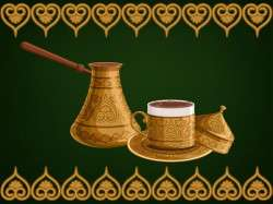 Turkish decorated copper cezve and cup of coffee