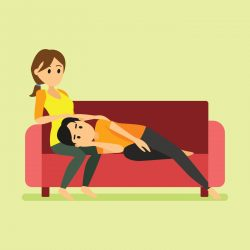 A man laying on her girlfriend thigh