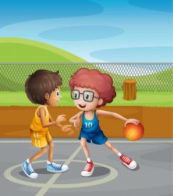 Two boys playing basketball at the court